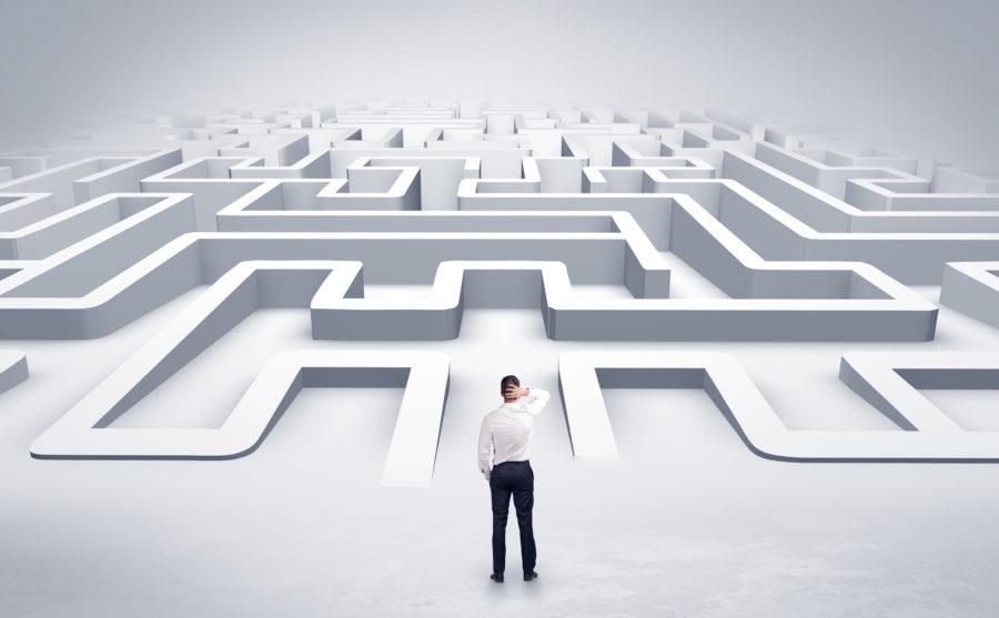 Businessman starting a flat 3d labyrinth